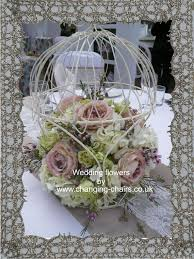 open sided wedding bird cage and flowers