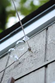 diy garden string lights. love this: how to hang outdoor lights! what an easy and inexpensive way diy garden string lights