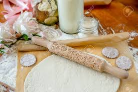 Rolling Pin With A Pattern On A Wooden Decorated Table Covered