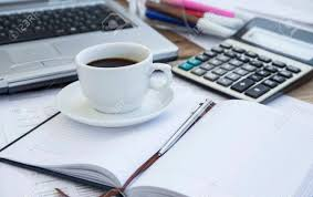 office agenda coffee cup at office with paperwork agenda and pen calculator