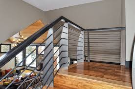 interior-design-firm-chicago - Custom walnut staircase with metal blade  posts designed