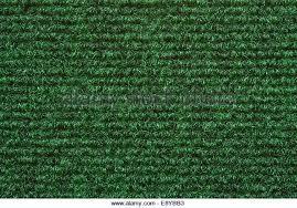 green carpet texture. a green carpet texture - stock image