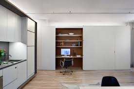 Open Kitchen Partition Modern Loft Removes Partitions In Favor Of A Plywood Volume