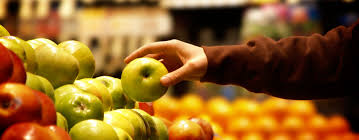 bd nutrition food marketing bsc undergraduate a person picking up an apple from a supermarket display