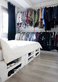 pallet bed offering storage space