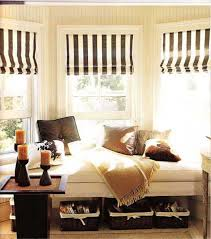 bay window seat with storage and black and white window curtains