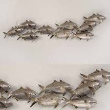 on copper dolphin wall art with school of sardines wall art