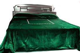 luxury bedspread in dark green velvet couture bed linen in velvet plush blanket