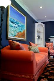 Orange And Blue Living Room Traditional Style Living Room With Midnight Blue Walls Looks