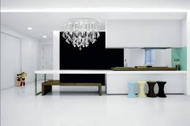 kitchen design interior with crystal modern light fixtures decorated with white cabinet and wooden bench for