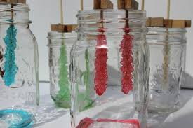 growing your own rock candy sugar crystals is a delicious science experiment to do with kids