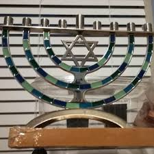 a centerpiece of the celebration hanukkah is the menorah the ancient l holds nine candles