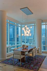 8 10 area rugs dining room contemporary with chandelier city views colorful area rug dining table light