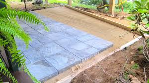 the ability to lift and hold paving stones with two hands likely will determine whether homeowners can install patio pavers themselves tim carter photo