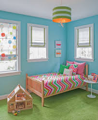 girl s room with aqua blue walls grass green rug and pink chevron bedding