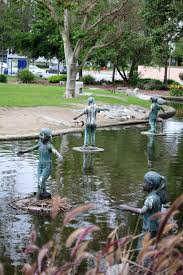 trees nature park foliage pond statue photography by tanya brown
