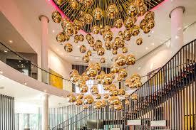 tom dixon mirror ball arrangement in the lobby of the hilton estonia