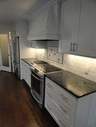 Tile Backsplashes With Granite Countertops Awesome Blue Pearl Granite Counter With White Subway Tile Backsplash Low