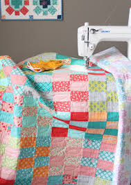 Finished Jelly Roll Stash Buster Quilt | Cluck Cluck Sew & Easy Jelly Roll Quilt with Free Tutorial Adamdwight.com