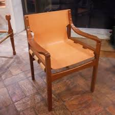 wood and leather chair. One-piece Chair In Natural Leather And Wood