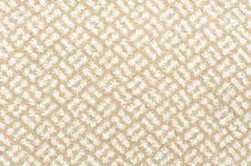 carpet pattern. a woolen beige and white carpet with relief pattern stock photo - 16468912 e