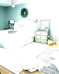rug placement under queen bed for area bedroom size master ideas sierra paddle rugs small sizes
