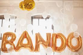 gilded modern wedding inspiration downtown reception gold balloons original