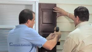installing exterior wood shutters. installing exterior wood shutters