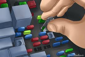 how to inspect car fuses yourmechanic advice  fuse box being pulled out by person