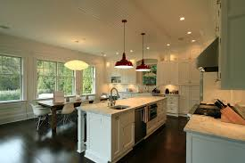 red pendant light Kitchen Contemporary with bead board dark stained. Image  by: Heartwood Corp