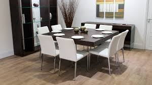 square dining table with white dining chairs