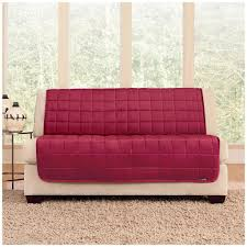 beige armless loveseat with red quilted sofa slipcover
