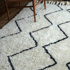 white and grey rug black