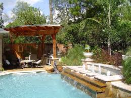 Exterior:Excllent House Swimming Pool Backyard Design Ideas With White Jump  Board Also Stripes Lounge