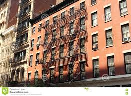 New York Brick Buildings With Outside Fire Escape Stairs Stock - New york apartments outside