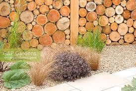 Garden Design Images Mesmerizing GAP Gardens Timber Wall Created By Pattern Of Logs And Gravel Bed