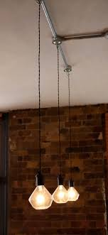 funky lighting ideas. diamond light bulb trio with bakerlite fittings and antique cord dropped from steel conduit funky lighting ideas g