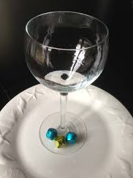 jingle bell wineglass charms add a fun al element to a party