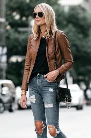 blonde woman wearing tan leather jacket black tshirt denim ripped skinny jeans outfit chloe faye handbag