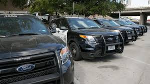 in this tuesday july 11 2017 photo austin police ford utility vehicles are parked on east eighth street outside police headquarters in austin texas