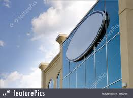 office space cover. Office Architecture: A Circular Blank Sign On The Corner Of An Building, With Space Cover