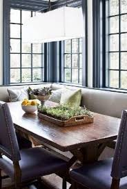 the breakfast nook continues to be a home s most important spot for family meals and good conversation the banquette and chairs are upholstered in vinyl