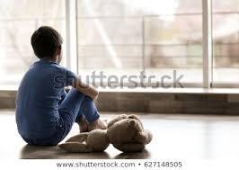 Стоковая фотография «Sad Little Boy Sitting On Floor» (изменить ...