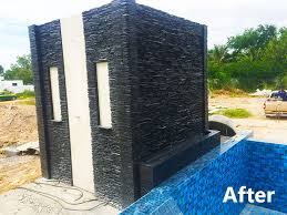 stacked slate water wall feature for