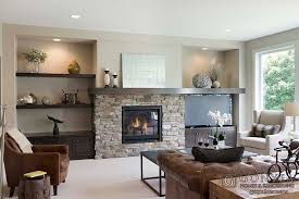 great room with stone fireplace and built ins by gonyea homes in the harriet elevation a