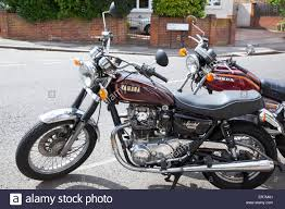 a yamaha special 650 and honda 400 motorcycles parked on the