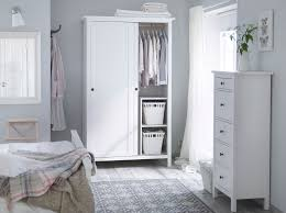 bedroom cupboard. a traditional white bedroom with hemnes wardrobe and chest of drawers in cupboard