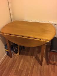 light oak round dining table folding sides