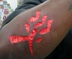 Ultimate Red Ink Extreme Letters Tattoo