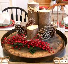 barrel of wood with dried pines candles and log decoration